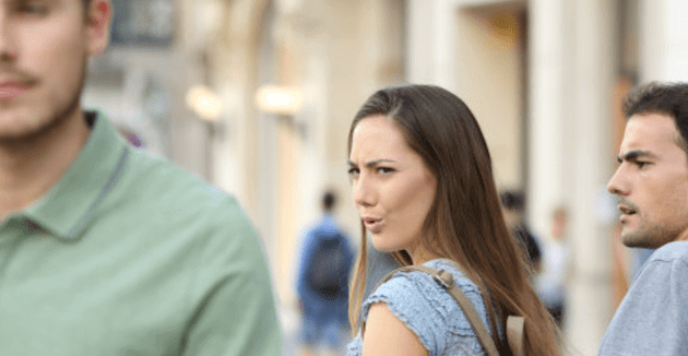 Woman starring at a sexy man.